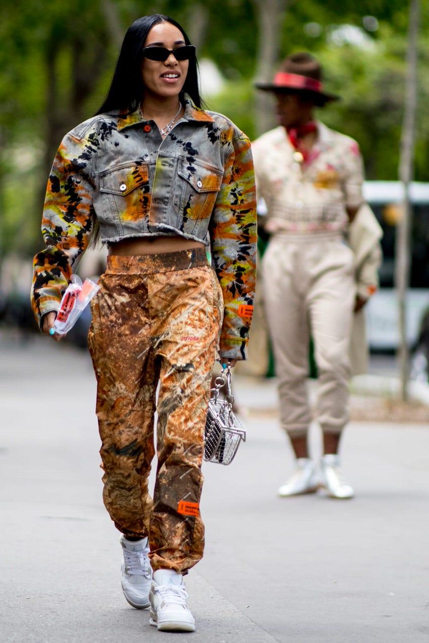 """Milan: <a href=""""https://fashionista.com""""target=""""_blank"""">Fashionista</a>"""