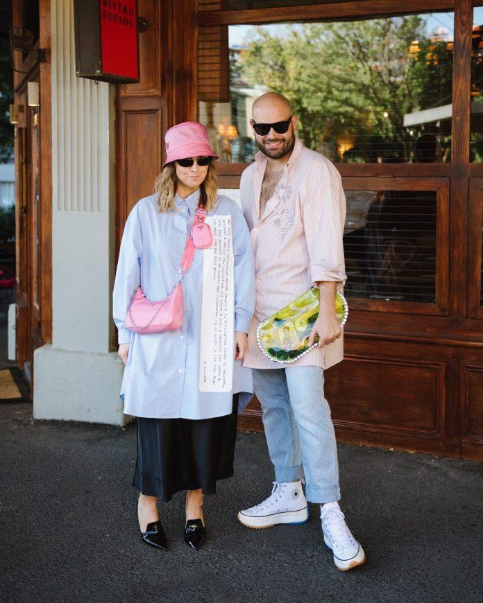 Matching couple posing street style