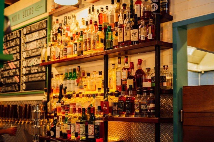 The bar at NOLA bottles of bourbon on display