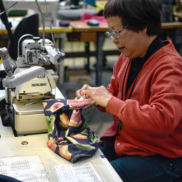 Worker making Solomon Street Garment - made in Australia