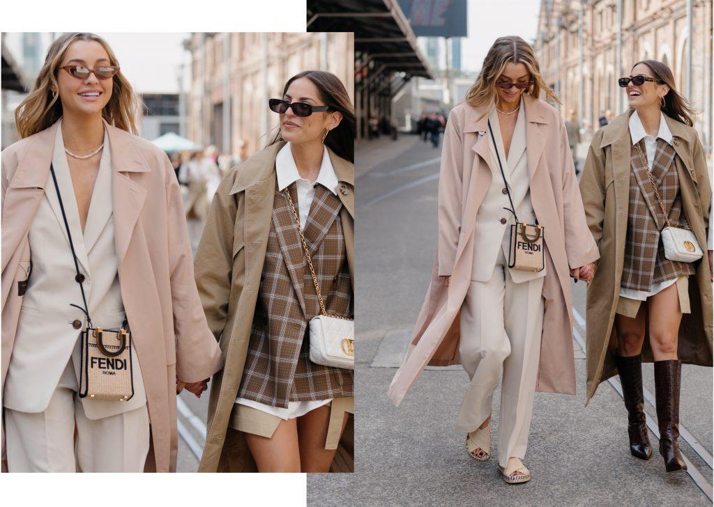 Happy women in oversized coats arriving for Australian fashion Week