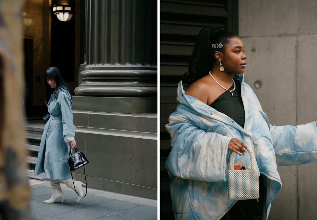 Two different women wearing light blue coats at Fashion Week