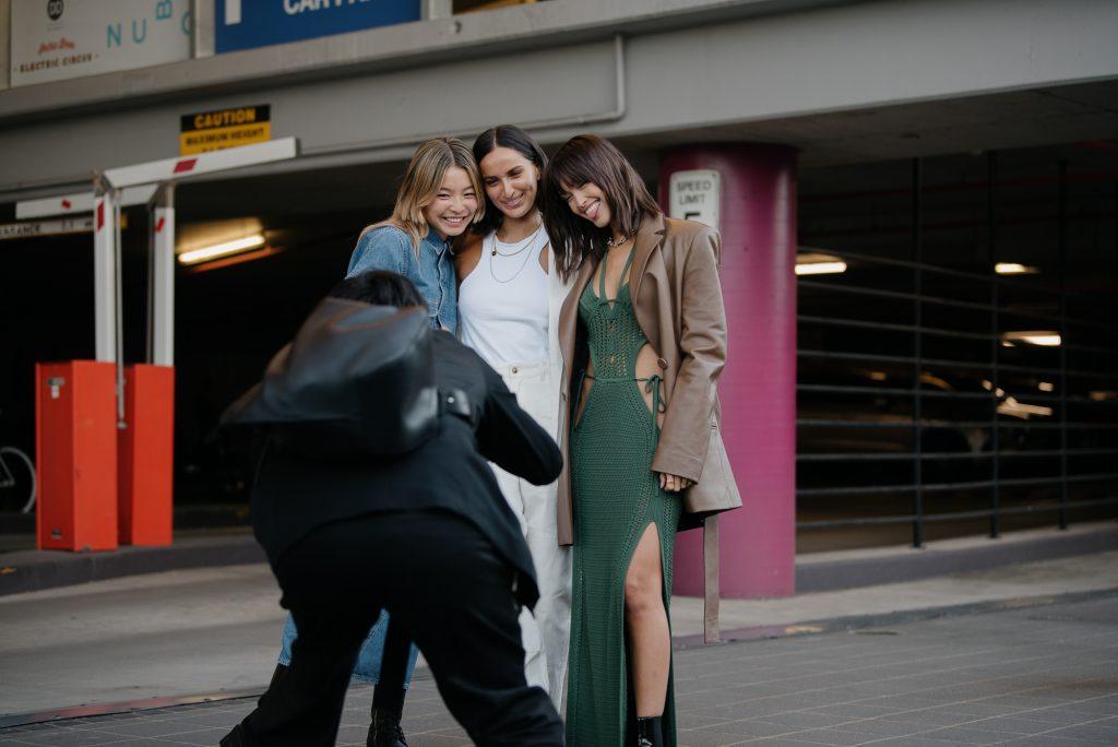 Three Fashionistas posing for the camera at Australian Fashion Week Streetstyle