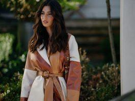 Woman in three-tone coat