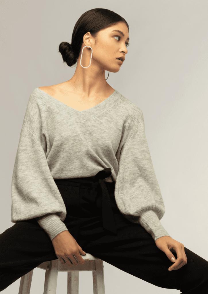 minimalist earrings worn by model