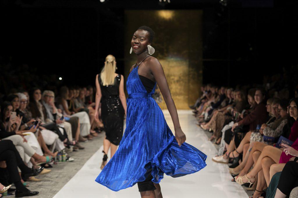 black model in blue dress on the runway - Brisbane Fashion Festival 2021