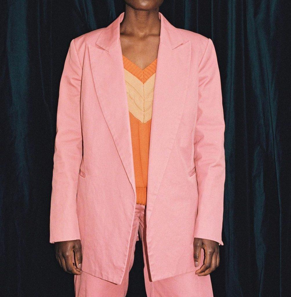 Tangerine V neck vest under pink suit