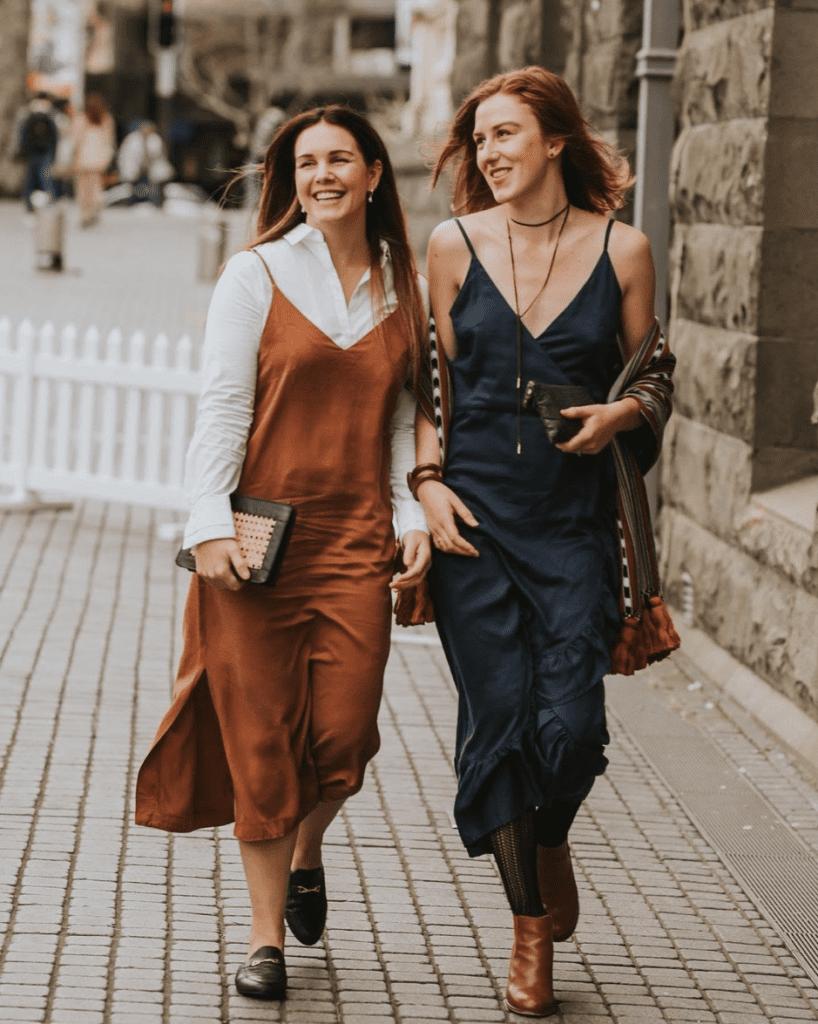 Two Women walking down the stree